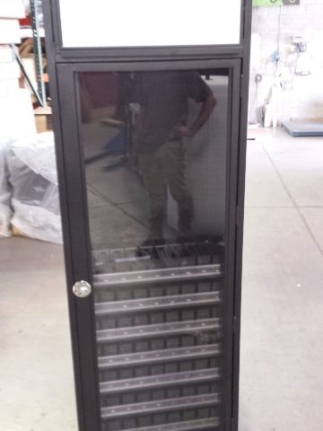 Custom tobacco cabinet with LED header and locking door