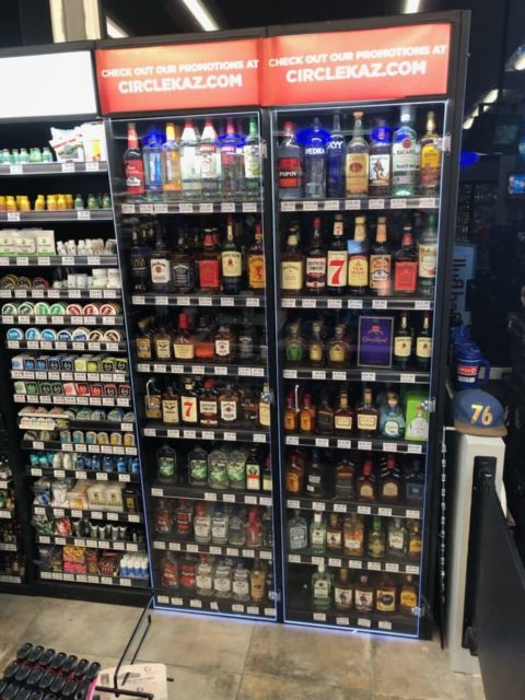 Liquor display cabinets with security doors