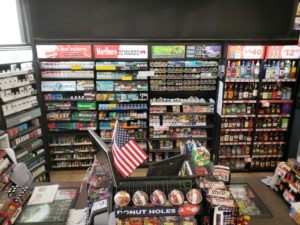 Cigarette sales display with liquor cabinets